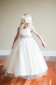 an ivory flower girl dress with blush pink on the With dresses for flower girl in wedding
