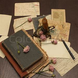 Vintage background with old books, postcards, photographs ...