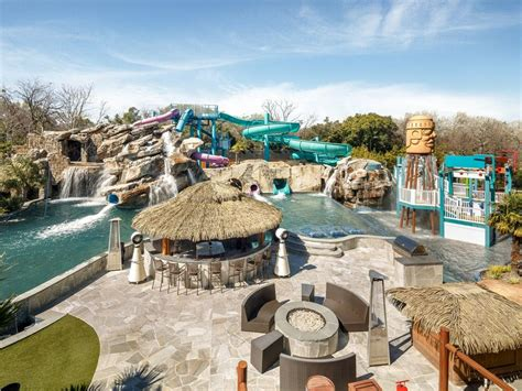 Backyard Water Park - 32m mansion has waterpark in ground troline in