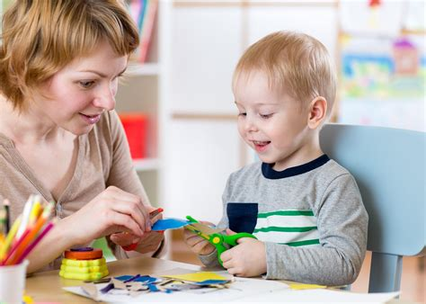 the benefits of early childhood education degree programs 861 | bigstock Woman teaches child handcraft 121826915