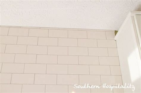 white subway tile backsplash with gray grout colors