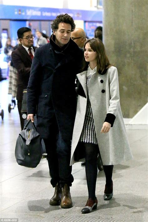 Felicity Jones lands in New York with beau Charles Guard ...