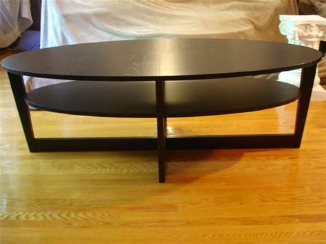 vejmon coffee table black brown ikea vejmon oval black coffee table 55 quot x 26 quot x 18 5 quot hard