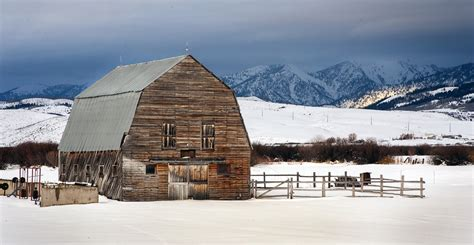 Wyoming Winter | An old barn stands out in a field of snow ...