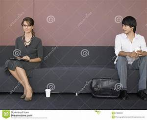 Business People Sitting On Sofa In Waiting Room Stock ...