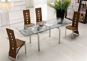 Extendable clear glass top leather modern dining table for Dining glass table set