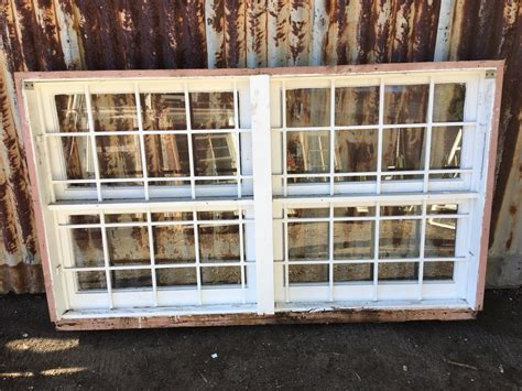 timber  panel awning window  steel security bars