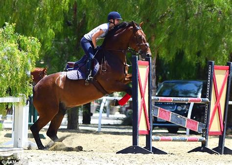 kaley cuoco  poised  practicing show jumping