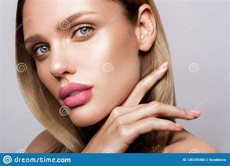 Beautiful Young Model With Pink Lips Nude Manicure Stock