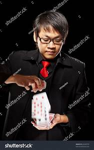 Chinese Male Magician Holding Cards Against Dark ...
