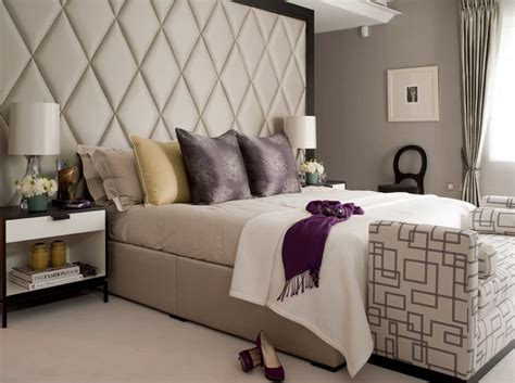 Low And Wide Bookcase by Bright Padded Headboard In Bedroom Transitional With