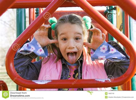 A Little Child Sticking Out Tongue Royalty Free Stock