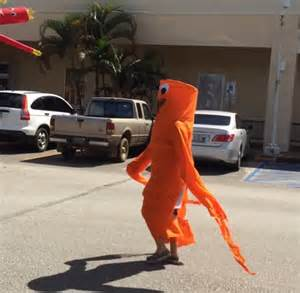 woman  inflatable tube man costume dances