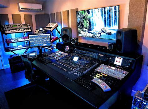 recording studio mixing desk in the studio with richard devine headphone commute