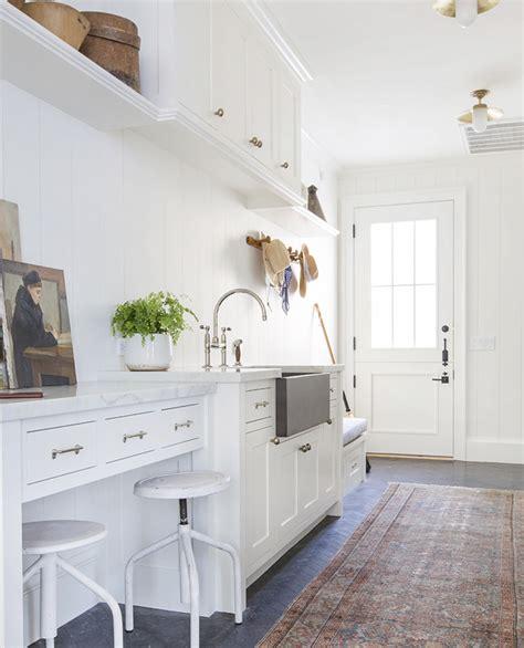 white laundry room vintage rug runner split door