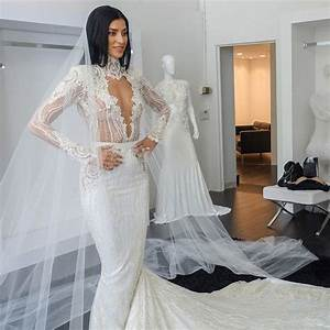 nicole williams in her wedding dress and veil by michael With michael costello wedding dress