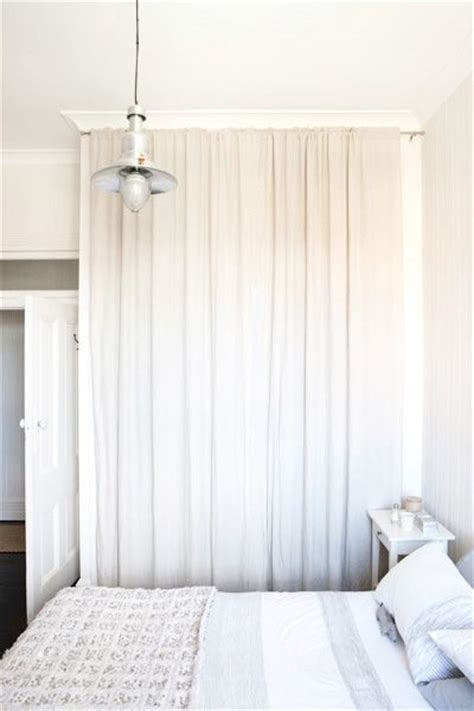 take out the closet doors and use a curtain rod to hang