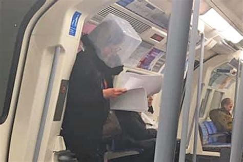 londoners don inventive face masks  headgear  tube
