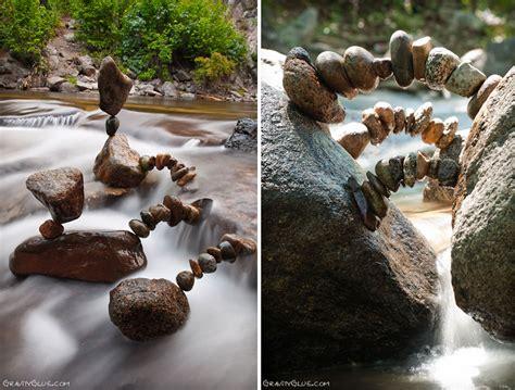 rock balancing artist creates impossible towers of balanced rocks to