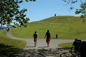 Two people walking onto the post industrial Gasworks park ...