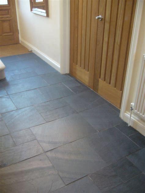 rectangular black slate slabs tiled on hallway floor