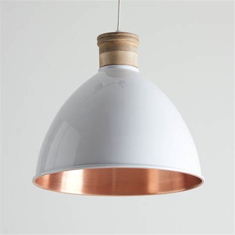 white and copper pendant lights by horsfall wright