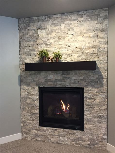 corner fireplace  silver travertine stacked stone