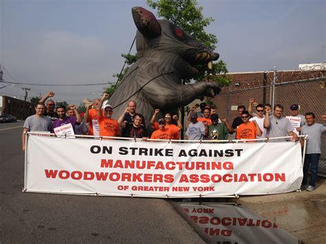 carpenters continue strike  manufacturing