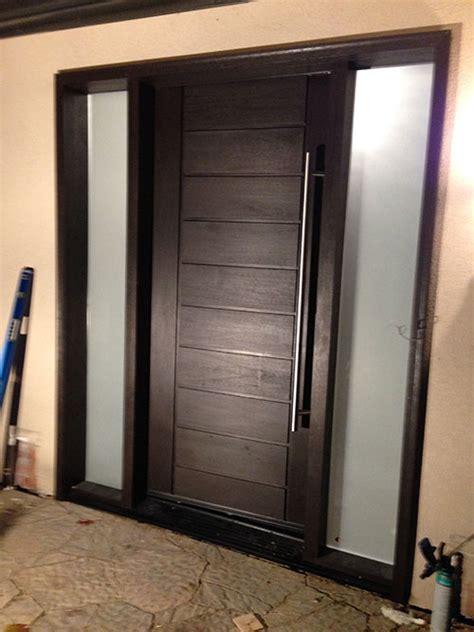 modern contemporary front entry fiberglass door  multi point locks  frostes side lites