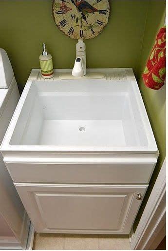 utility sink inside base cabinet   Laundry Room