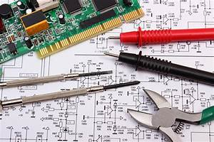 Printed Circuit Board  Precision Tools And Cable Of Multimeter On Diagram Of Electronics Stock