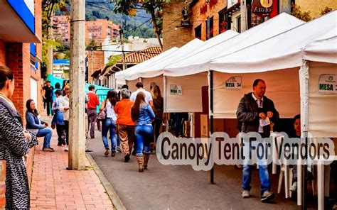 canopy tent  vendors  standing    outdoor business outdoor axis