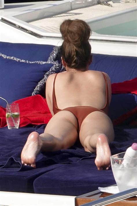 chrissy teigen   red swimsuit   yacht  portofino