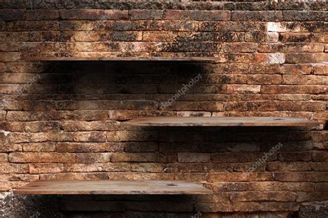 empty wood shelves   brick wall background grunge