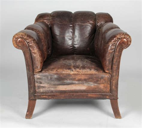 20th century distressed vertical tufted leather club
