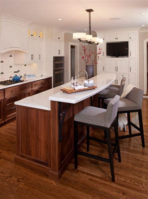 white kitchen island with breakfast bar ideas white and walnut kitchen transitional kitchen