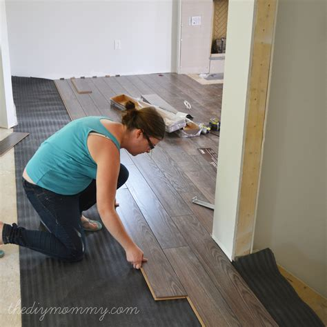 laminate flooring install wood installing diy floors floor mommy pets families oak roth allen laying rustic basement hardwood installation carpet