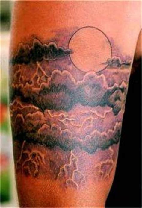 magnificent sun  clouds tattoo design  men