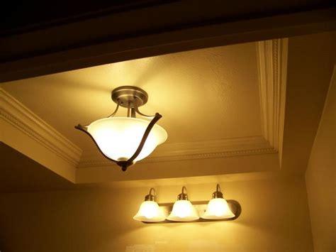 spectacular lighting update moldings fluorescent light fixtures   kitchen