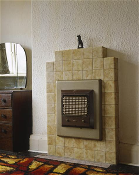 electric fire fitted   tiled fireplace