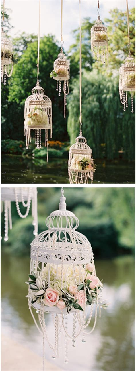 white bird cages for weddings white bird cages flowers pearls so pretty for an outdoor wedding or bridal shower http
