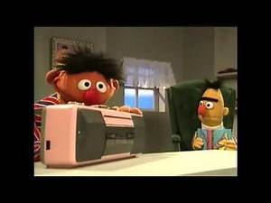 Ernie listens to Proto-heavy metal music while Bert reads his book