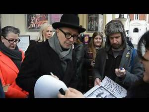 Gary Oldman signs autographs in Covent Garden, London