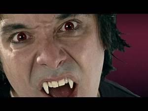 Retractable Vampire Fangs - HalloweenCostumes.com