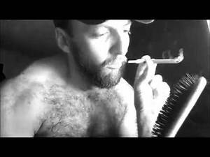Bearded Sultan Of Smoke Brushes His Chest Hair