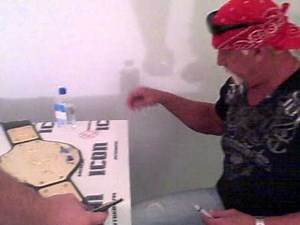 Hulk Hogan Signing WWF Belts for American Icon Autographs